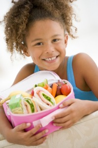 young girl holding a healthy lunch